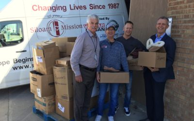 Goldeyes Donate Shoes to Siloam Mission