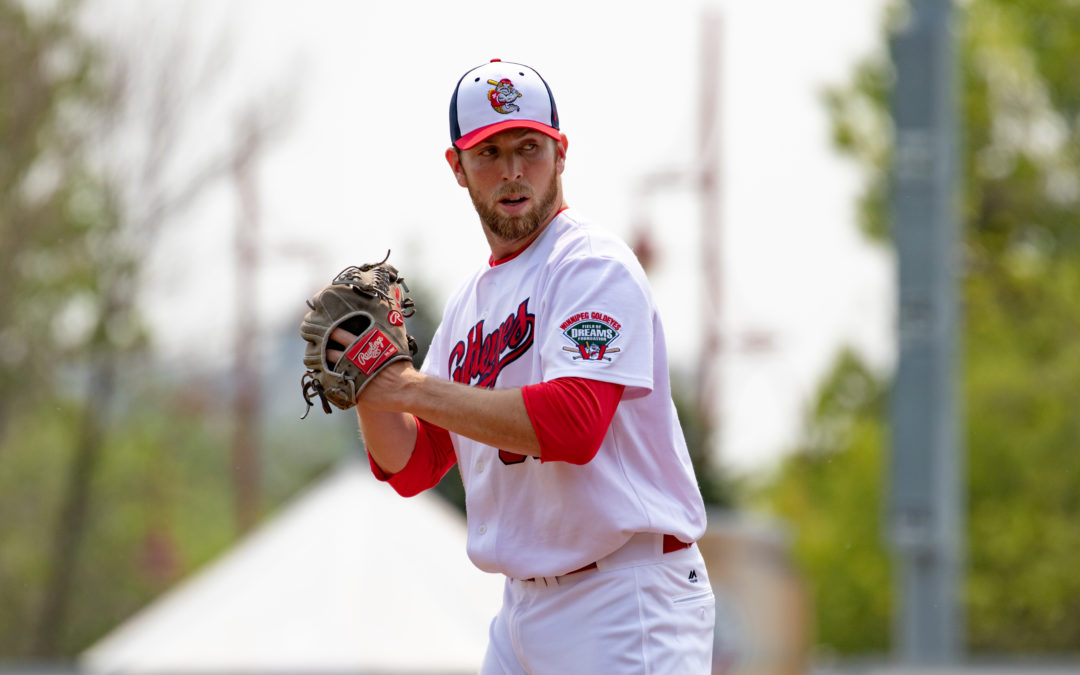 Dogs Outlast Goldeyes in Rainy Affair